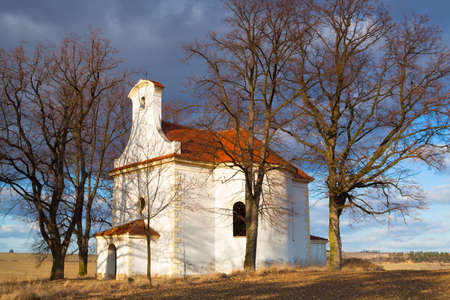 repaired: Repaired small church on a hill in Neprobylice between fields Stock Photo