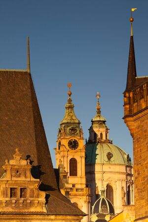 Sunrise on Charles Bridge in Prague - St.Nicholas cathedrale.