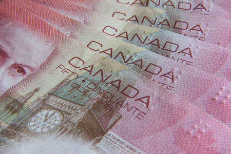 numismatic: Canadian banknotes of the same value on the desk