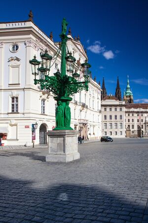 recollection: Historic Street lamp and Archbishops Palace at the Castle Square, Prague, Czech Republic