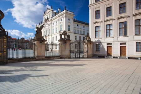 recollection: Prague,Czech Republic - March 4,2015:View on Archbishops Palace from the First Courtyard of Prague Castle. In the First Courtyard that visitors to Prague can witness the changing of the guards.