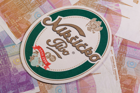 molson: Croatia,Novigrad - August 13,2014: Beermat from Niksicko  beer and Croatia money.Trebjesa Brewery is the only brewery in Montenegro.It is based in Niksic, and is owned by Molson Coors.