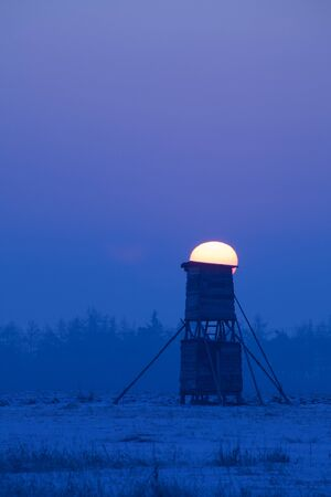 hunters tower: Winter scenery with hunters tower at late evening Stock Photo
