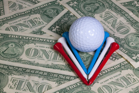 money sphere: Golf equipments and US dollar banknotes