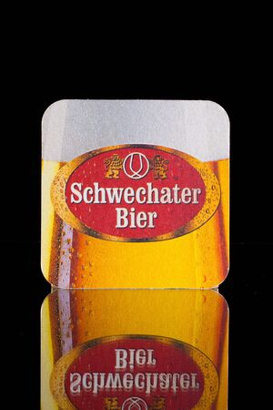 illustrative material: Wien,Austria-December 13,2014: Beermat from Schwechater beer.The history of the Schwechater beer started in the year 1632. Peter Descrolier, who was valet and paymaster of archduke Matthias, founded the brewery in Schwechat.