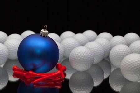 christmas golf: Blue Christmas decoration a golf balls on a black glass desk
