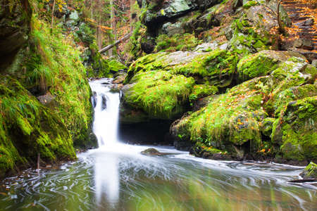 Waterfall in Doubravka valley  in autumn - Highlands in Czech Republic photo