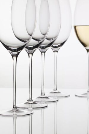 oenology: Five glasses  of  wine and on the white background