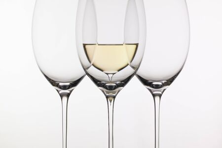 oenology: Four glasses of wine on the white background Stock Photo