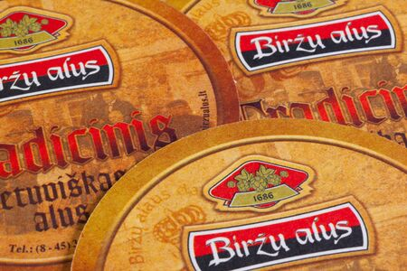 illustrative material: Austria,Wien - December 15,2014:Beermats from Birzu Alus beer. It is an ancient beer from Lithuania, which was established in 1686.This kind of beer has the heritage of technology and beer producing for over 300 years. Editorial