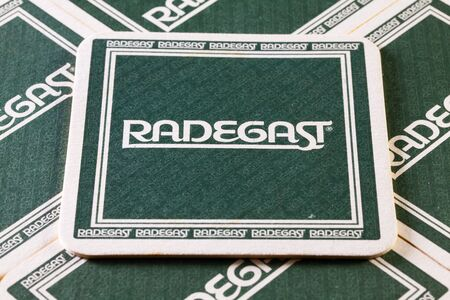 illustrative material: Prague,Czech Republic-December 3,2014:Beermats from Radegast  beer.Radegast is a Czech beer brewed in Nosovice, Moravian-Silesian Region, Czech Republic since 1970. The beer is named after the god Radegast.