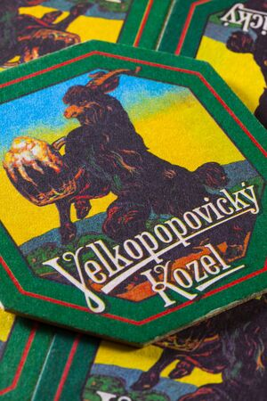 illustrative material: Prague,Czech Republic-December 3,2014:Beermats from Velkopopovický Kozel beer.It is a Czech lager produced since 1874. In that year, Franz Ringhoffer founded a brewery in Velké Popovice, a town 25 km southeast of Prague Editorial