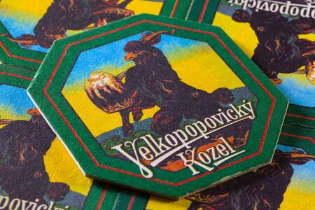 velke: Prague,Czech Republic-December 3,2014:Beermats from Velkopopovický Kozel beer.It is a Czech lager produced since 1874. In that year, Franz Ringhoffer founded a brewery in Velké Popovice, a town 25 km southeast of Prague
