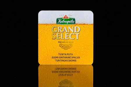 illustrative material: AUSTRIA,LINZ - January 12,2015:Beermat from Kalnapilis beer.Kalnapilis is a Lithuanian brewery, established by Albert Foight in Panevezys in 1902