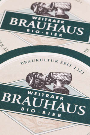 illustrative material: Austria,Wien - December 15,2014:Beermats from Brauhaus Bio Beer.Brauhaus Beer is brewed in Austrias oldest beer brewing town Weitra