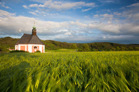 renovated: Renovated church on the edge of a cornfield at sunset Stock Photo
