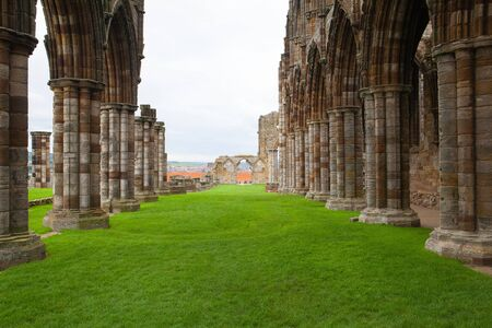 abbeys: Famous Whitby Abbey in England.Whitby Abbey is a ruined Benedictine abbey overlooking the North Sea on the East Cliff above Whitby in North Yorkshire, England.