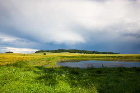 harvest time: Harvest time - summer landscape after heavy storm Stock Photo