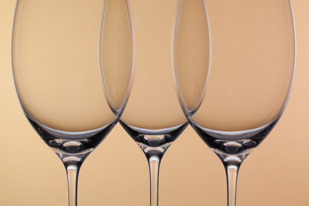 oenology: Three empty glasses of wine on a background Stock Photo