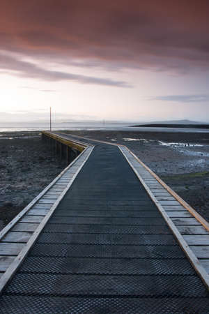 great britain: Sunset on the jetty in Morecambe Bay, Morecambe, Great Britain Stock Photo