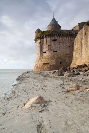 abbeys: Low tide at the abbey of Mont Saint Michel, Normandy, France Stock Photo