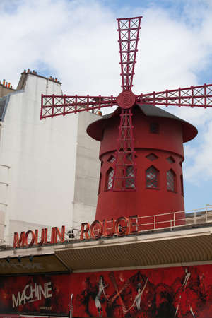 moulin: Paris, France-June 23,2012:  The Moulin Rouge cabaret in Paris.The original house, which burned down in 1915, was cofounded in 1889