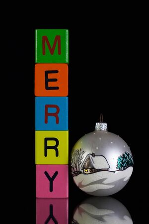 Colored childrens cubes and Christmas decoration on a black glass desk Stock Photo
