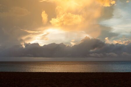 rance: Sunset on the beach of Grande Anse after heavy storm,Deshaies, Guadeloupe island