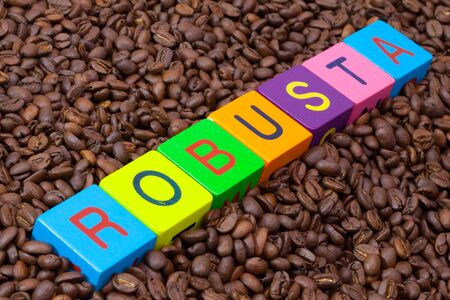 acidity: Colored childrens cubes and coffee beans - Robusta is a sturdy species of coffee bean with higher acidity and high bitterness