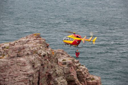 bretagne: Brittany,France - September 27,2010: Search and rescue maneuver by Marine Rescue helicopter ,Bretagne,France