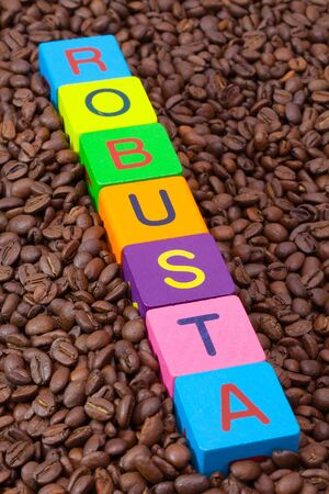 robusta: Colored childrens cubes and coffee beans - Robusta is a sturdy species of coffee bean with higher acidity and high bitterness
