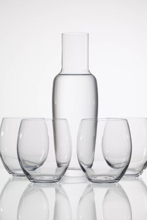 clearness: Glasses of water on the glass desk