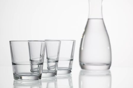 purity: Glasses of water on the glass desk