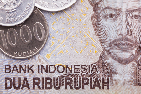 rupiah: Indonesian money rupiah banknote and coins, close-up
