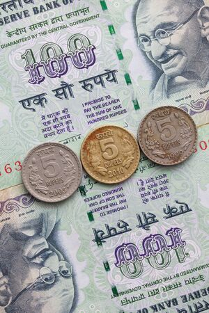 profiting: Different banknotes and coins  of Indian Rupee