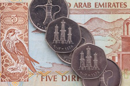 middle east crisis: Different banknotes and coins of Arab Emirates Dirham
