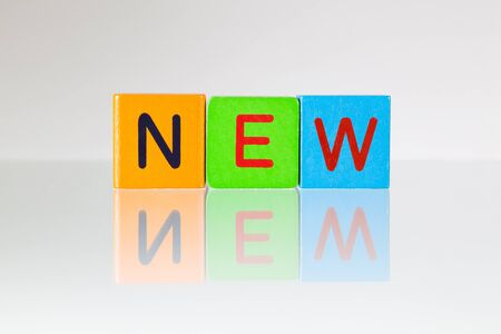newness: New - an inscription from childrens wooden blocks