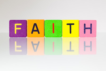 recollection: Faith - an inscription from childrens wooden blocks Stock Photo