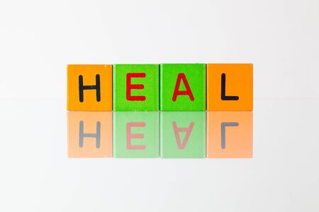 soothe: Heal  - an inscription from childrens wooden blocks Stock Photo
