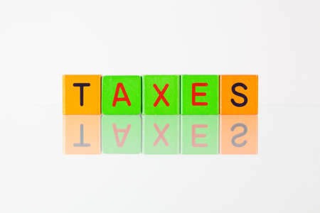 rate of return: Taxes - an inscription from childrens wooden blocks
