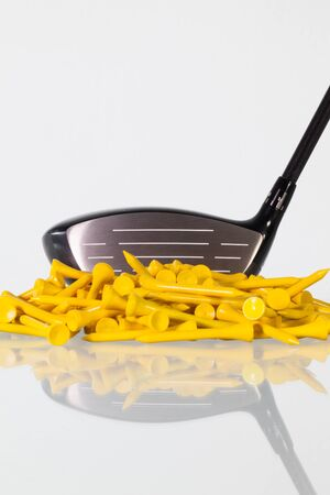 golfcourse: Golf driver and wooden tees on a glass table Stock Photo