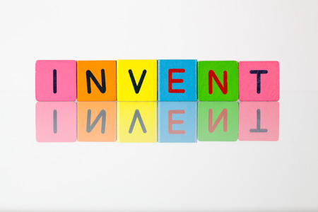 invent: Invent - an inscription from childrens wooden blocks