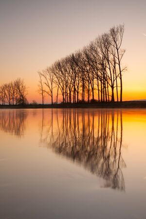 symmetry: Symmetry - Reflection on the morning river.