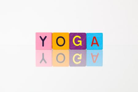 Yoga - an inscription from childrens wooden blocks Zdjęcie Seryjne