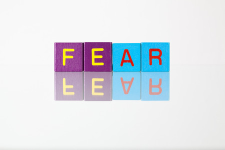 affraid: Fear - an inscription from childrens wooden blocks Stock Photo