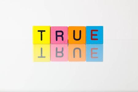 true: True - an inscription from childrens wooden blocks