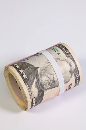 bribery: Bribery - The roll of dollar bills with plastic band over the eyes