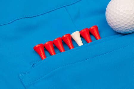 trousers: Detail of blue trousers  and golf equipments