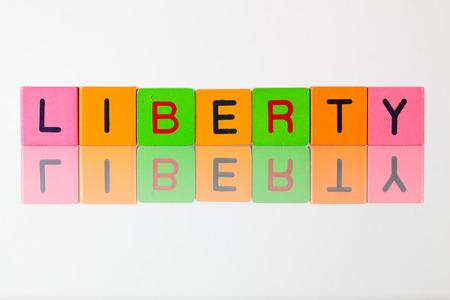 d�livrance: Liberty - an inscription from childrens wooden blocks
