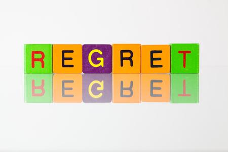 regret: Regret - an inscription from childrens wooden blocks